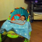 Braveheart Zachary sleeping soundly in his musical vibrating chair